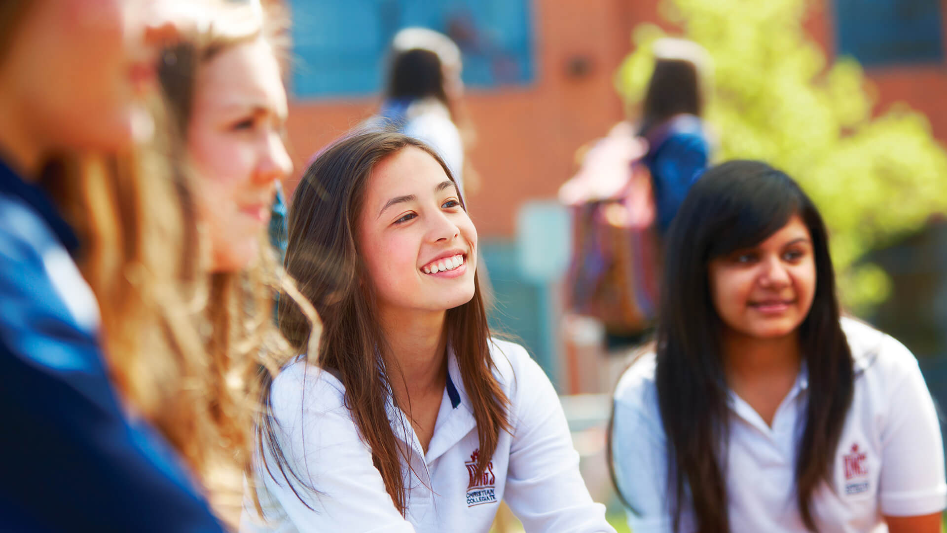 group of female students smiling outside