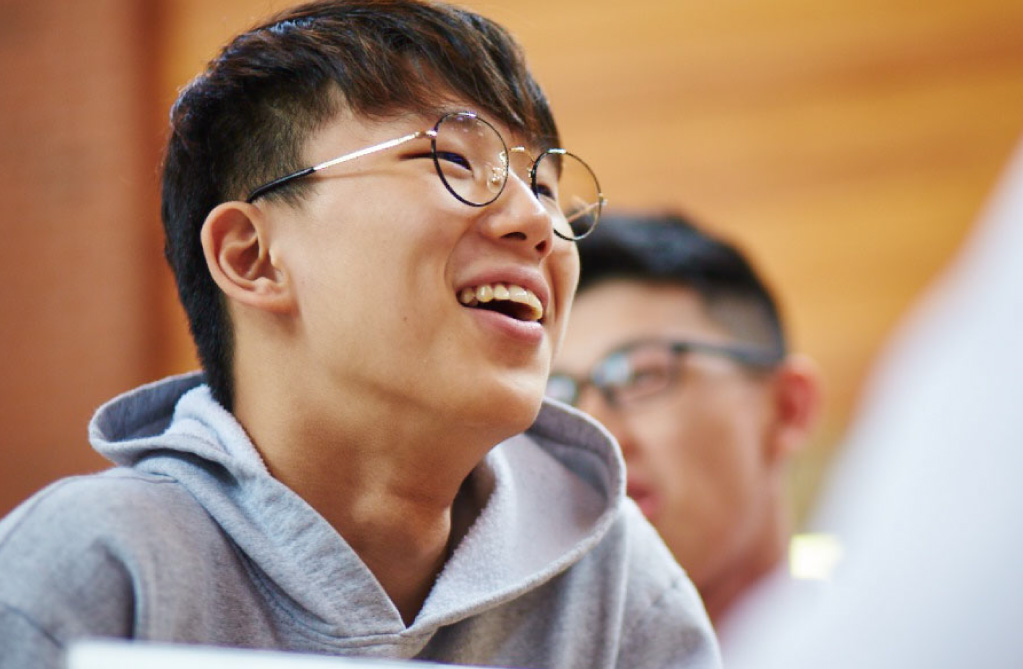 male student laughing in cafeteria