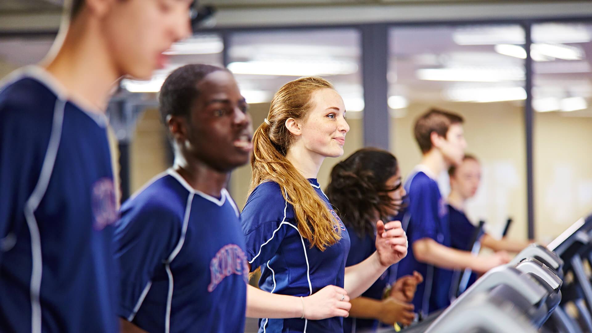 students exercising on treadmills
