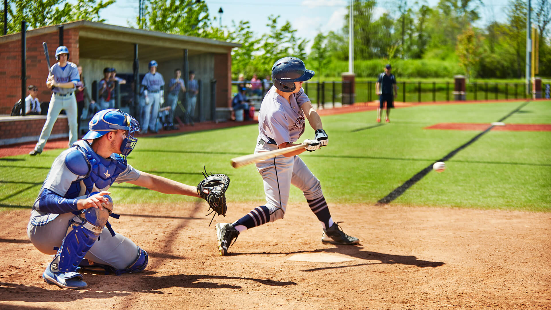 students playing baseball