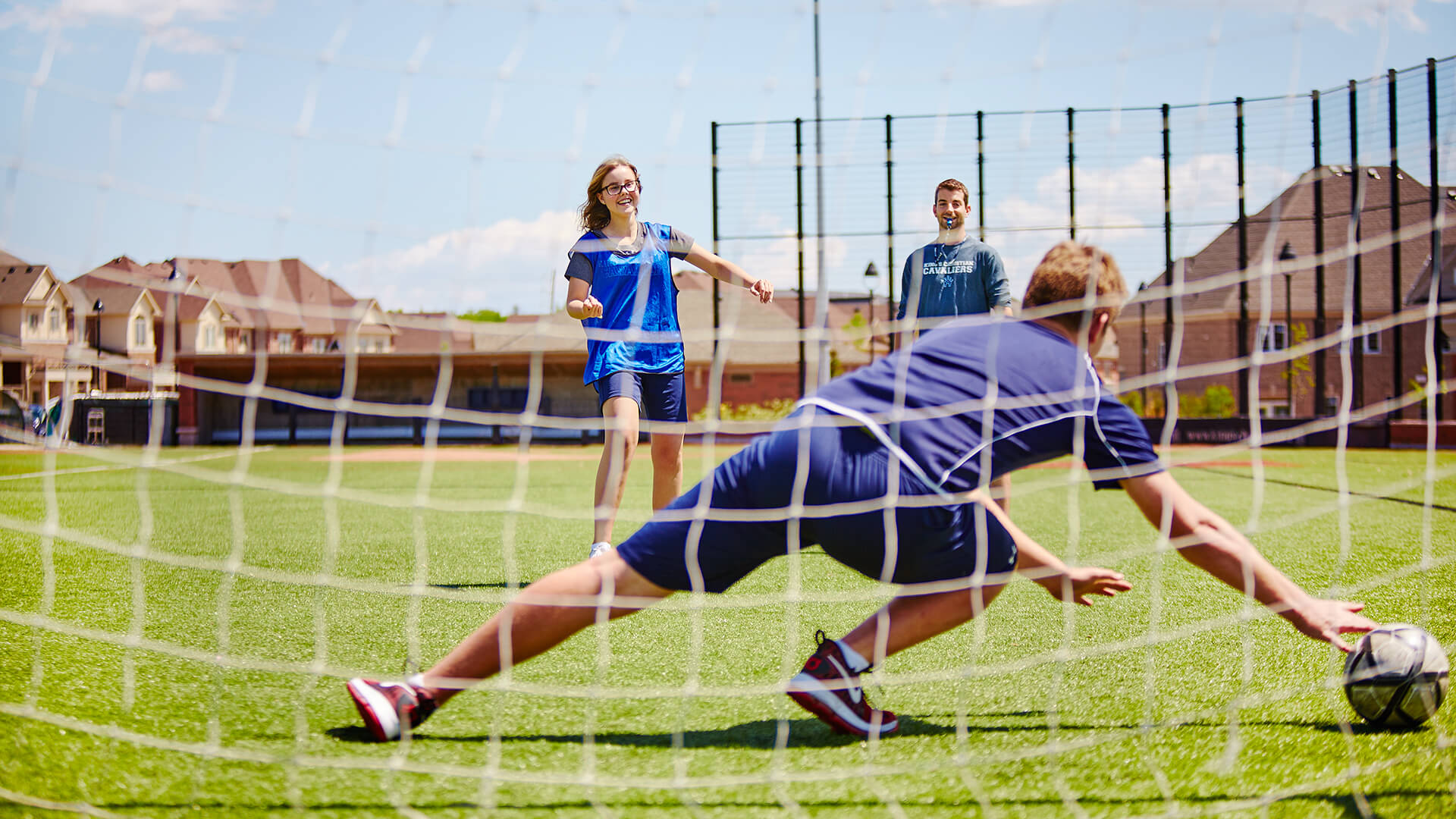soccer coach practicing with students