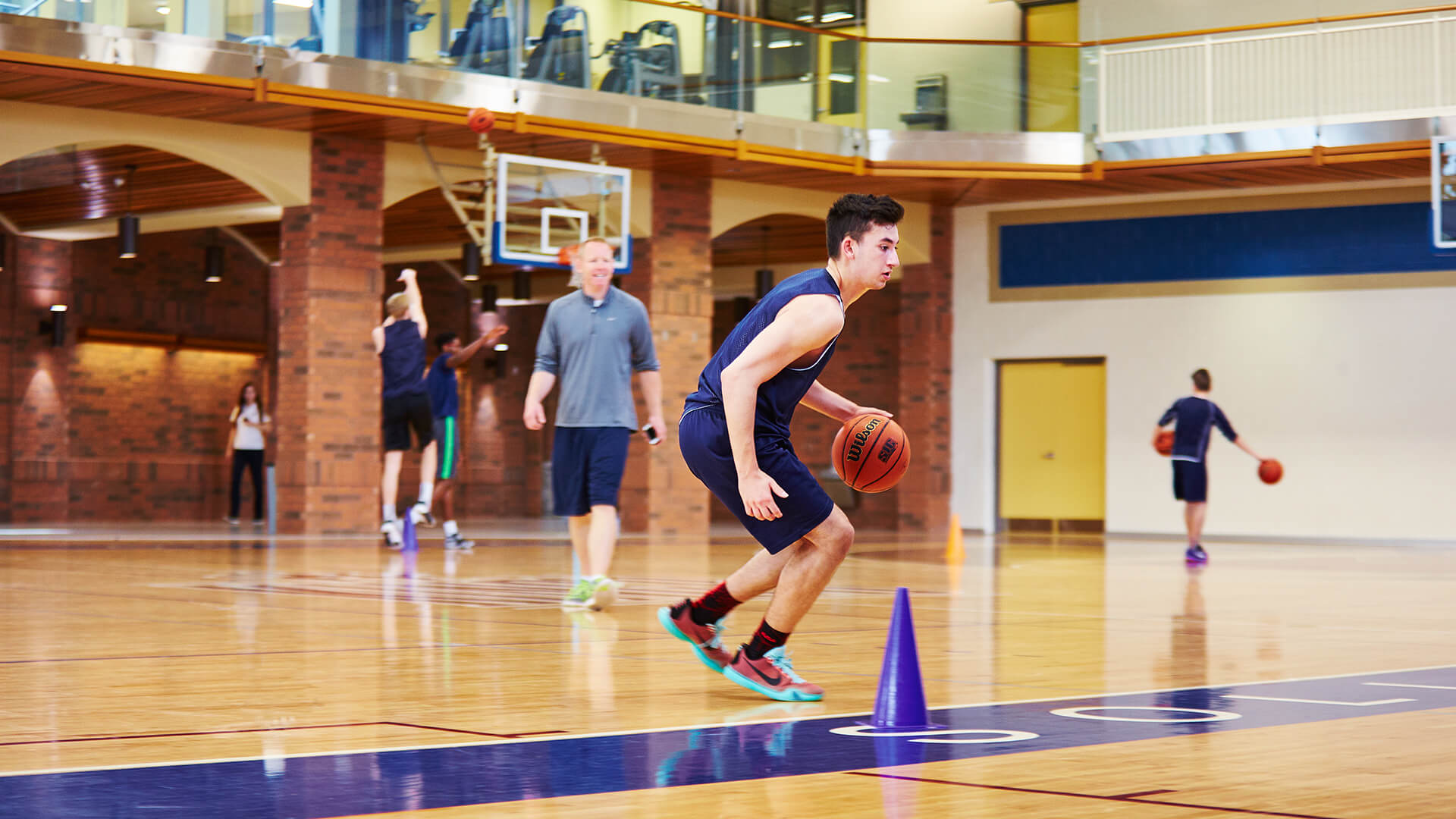 male students playing basketball